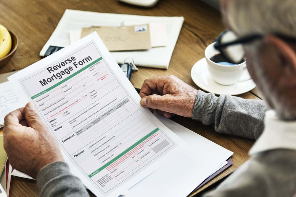 Man holding Reverse Mortgage Form